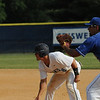 Gaithersburg Giants Opening Day in Criswell Stadium at Kelly Park <br /> <br /> Giants Brady Pollicelli stretches a lead while Thunderbolt Jack Taylor holds him at first base