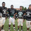 NW Football Team Captains - Left to Right - OLB Chuck Anya, ILB Brendan Thompson, RB E. J. Lee and Center Austin Wickham.