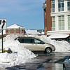 Kentland Town Center Area. Snow Drifts as high as cars rooms greet traffic at the circle in Kentlands from the aftermath of the Blizzard