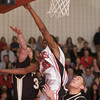 QO Andre Gaines fights for a rebound with Fredericks' Connor Corbett and Sky Benson in the 3A Playoff contest at QO