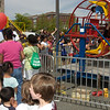 Kentland Days - May 1.  Many parents and children were in long lines waiting for their turn at the carnival rides.