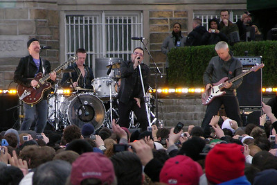 This shot covers all the bases.  Bono emoting, the Edge playing a Les Paul...and a Fordham hat in the foreground.