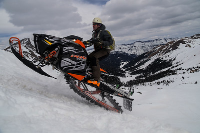 Terrain Dominator Mike H topping out on Star Pass on a practice lap, safety first!