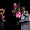 """""""Confronting Resistance: Fundamentals to Innovations"""", The 47th Union World Conference on Lung Health, Liverpool, United Kingdom. Photo shows: Closing Session. The Union's new President Jeremiah Chakaya Muhwa with flowers for Jane Carter. Photo©Marcus Rose/The Union"""