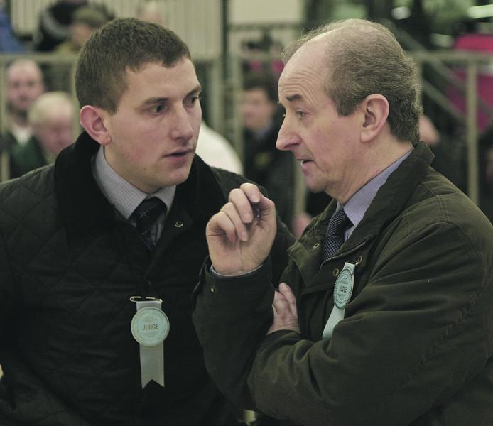 Aberdeen Christmas Classic 13 Judges Gary Raeburn left and Alan Healey seen considering the Champion.