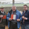 Dingwall Mart 2nd April 14. The Overall Champion a Blonde Cross Heifer from J&J Henderson,Udale Farm, Black Isle. Judge Tom Stevenson, Balmacolly, Bankfoot, Perth is seen in centre presenting the champion tickets sponsored by the Farmers Guardian on left John Henderson on rght Tom Henderson. The judge bought the champion for £1440 and also the reserve for £1360.