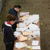 Ashford Market Store Cattle Sale<br /> Lizzy Burden [close to camera] sorts cattle passports out<br /> Picture Tim Scrivener 07850 303986
