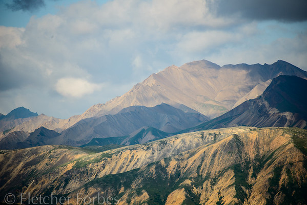 Denali National Park. Over 6 million acres of wild land, with one road running through it, which private cars are not allowed to use. They mean to keep it wilderness.