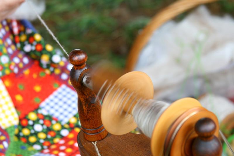 Spinning thread on a beautiful spinning wheel.