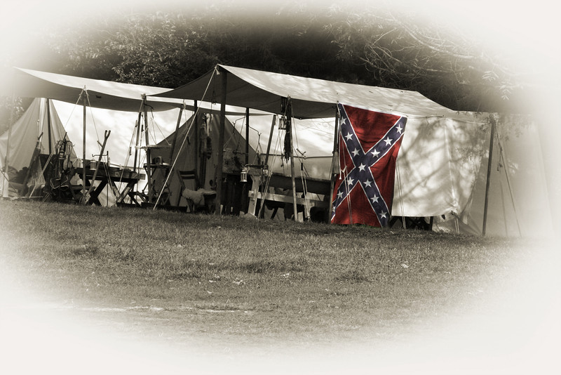 Colorized Civil War encampment with the Confederate flag.