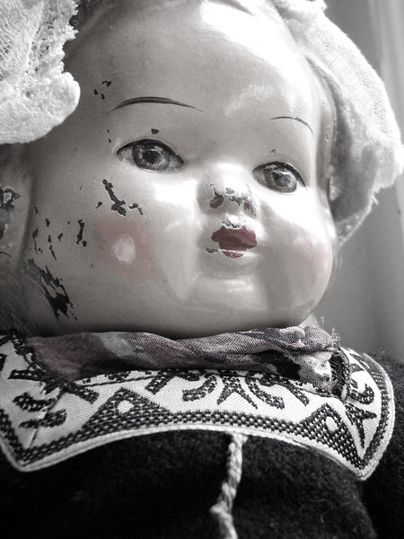 Antique wooden doll in a dutch costume.