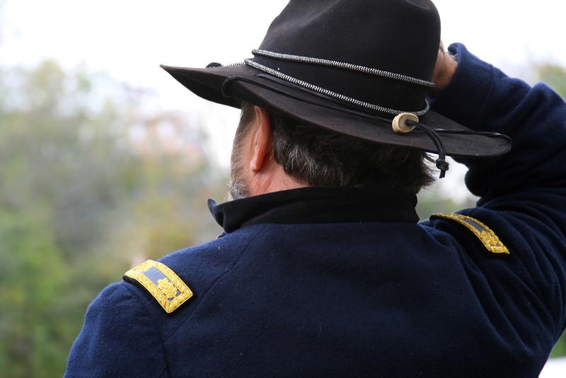 Civil war Union officer gazes into the hazy field.