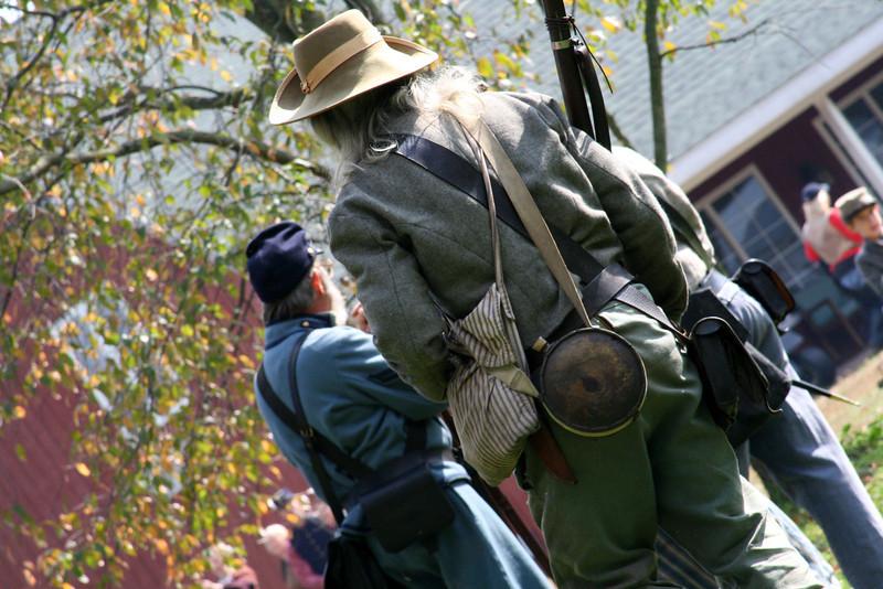 Bedraggled Civil war soldier in camp.