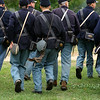 Union civil war soldiers run in formation.