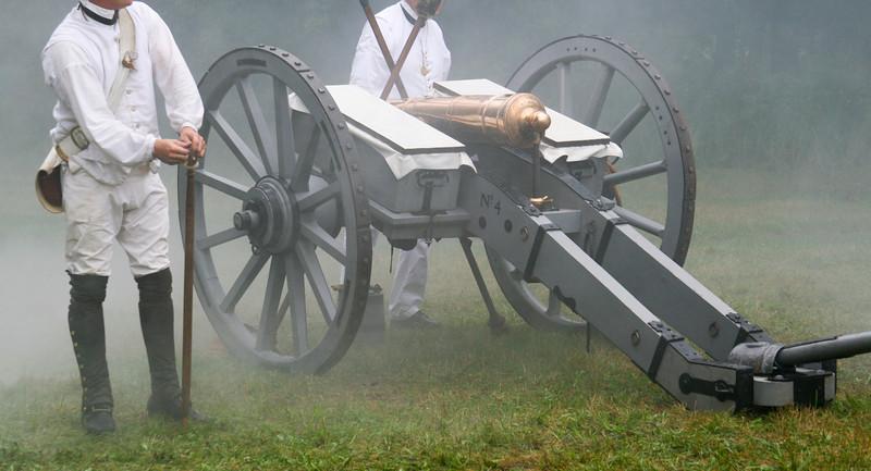Solders fire a Revolutionary War era canon.
