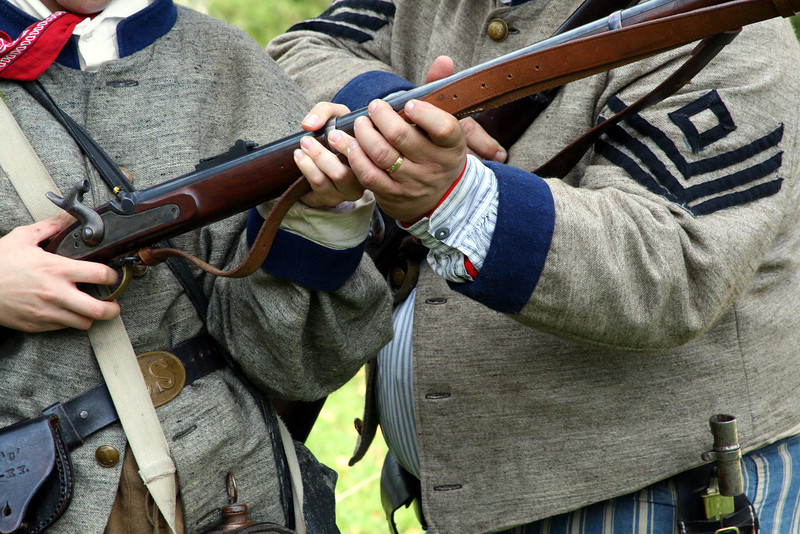 This Civil war soldier receives instruction on the firing of a musket.
