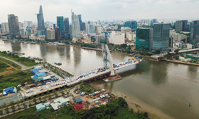 Land clearance roadblock delays major Saigon bridge completion