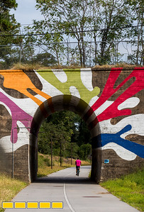 The HIghball Artist is a mural created by Hadley Breckenridge on the tunnel that runs under Lucille Street is on the Westside Trail of the Beltline.  The path is now paved, has lighting and security cameras and is officially open to the public.  The art piece, created in 2012, title The Highball Artist, is a reference to railroad slang for an engineer known for running trains fast.  (Jenni Girtman / Atlanta Event Photography)