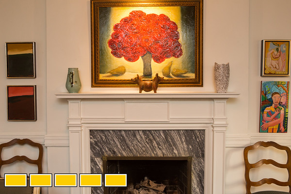 The five working fireplaces in the home are made with local Georgia granite and intricate trim work.  The family home where Yovy Gonzalez, pink shirt, and Mike Dorsey, blue shirt, live with their twin boys Llewyn, smaller, and Locke, 16 months old.  The home designed by architect Leila Ross Wilburn is on the Druid Hills home tour and has 5 working fireplaces, original trim and working radiators all standard in homes designed by Ross Wilburn.  (Jenni Girtman / Atlanta Event Photography)