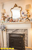 The boy's bedroom fireplace has the same Georgia granite and trim as is throughout the house as well as the original metal covers that helped keep warmth in the home. The family home where Yovy Gonzalez, pink shirt, and Mike Dorsey, blue shirt, live with their twin boys Llewyn, smaller, and Locke, 16 months old.  The home designed by architect Leila Ross Wilburn is on the Druid Hills home tour and has 5 working fireplaces, original trim and working radiators all standard in homes designed by Ross Wilburn.  (Jenni Girtman / Atlanta Event Photography)