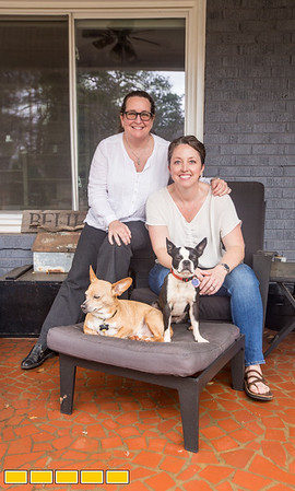 In Jefferson Park, a neighborhood in East Point, is the home of Paula Gumpman, left, Kelli Covington, right, and their five rescue dogs.  The home has been expanded on over the years and now has an upstairs aprartment above the two car garage and an out building the couple is rennovating.  (Jenni Girtman / Atlanta Event Photography)