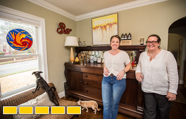 In Jefferson Park, a neighborhood in East Point, is the home of Kelli Covington, left, Paula Gumpman, right, and their five rescue dogs.  The home has been expanded on over the years and now has an upstairs aprartment above the two car garage and an out building the couple is rennovating.  (Jenni Girtman / Atlanta Event Photography)
