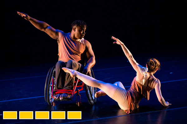 Full Radial Dance performers including DeMarco Sleeper, left, and McKenzie Beaverson take the stage during dress rehearsal for the The Modern Atlanta Dance Festival at Balzer Theater at Herren's in downtown Altanta  The troupe dances internationally and includes disabled and able bodied dancers. Douglas Scott is the Full Radial Dance's artistic/executive director and the founder of the MAD Festival.   (Jenni Girtman / Atlanta Event Photography)