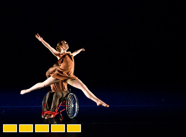 Full Radial Dance performers including McKenzie Beaverson, left, and DeMarco Sleeper take the stage during dress rehearsal for the The Modern Atlanta Dance Festival at Balzer Theater at Herren's in downtown Altanta  The troupe dances internationally and includes disabled and able bodied dancers. Douglas Scott is the Full Radial Dance's artistic/executive director and the founder of the MAD Festival.   (Jenni Girtman / Atlanta Event Photography)