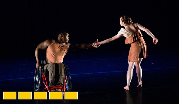 Full Radial Dance performers including McKenzie Beaverson, right, and DeMarco Sleeper take the stage during dress rehearsal for the The Modern Atlanta Dance Festival at Balzer Theater at Herren's in downtown Altanta  The troupe dances internationally and includes disabled and able bodied dancers. Douglas Scott is the Full Radial Dance's artistic/executive director and the founder of the MAD Festival.   (Jenni Girtman / Atlanta Event Photography)