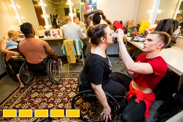 In the dressing room at at Balzer Theater at Herren's, Full Radial Dance performer Lindy Dannelley, center, gets final make up touch ups done by Mason Diaz as the group prepares for the The Modern Atlanta Dance Festival dress rehearsal downtown Atlanta.  The troupe dances internationally and includes disabled and able bodied dancers. Douglas Scott is the Full Radial Dance's artistic/executive director and the founder of the MAD Festival.  (Jenni Girtman / Atlanta Event Photography)