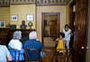 Isabella Harvey, 6, finds her seat with her mother before the Brer Rabbit storytelling at the Wren's Nest on Ralph David Abernathy Blvd.  Every Saturday talented story tellers entertain guests to the historic home. (Jenni Girtman / Atlanta Event Photography)
