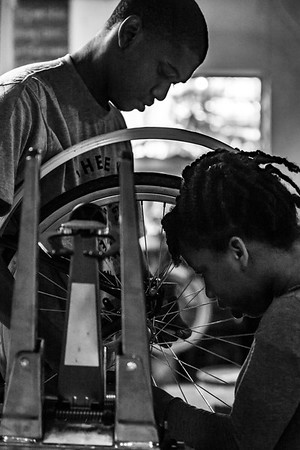 The Bearings Bike Shop on the Westside Trail is located at 982 Murphy Avenue and provides opportunities for the community to work toward owning their own bikes with merit programs and advanced job training; progressively learning bike repair and maintenance as well as the value of hard work and respect.  The Adair Park business  is Tim O'Mara's creation, has two locations and is expanding.  IDs below (Jenni Girtman/ info@atlantaeventphotography.com)<br /> <br /> Berings Bike shop in the west end<br /> Employee - Rico Simmons, 20 worked here 6 years, Bankhead English Ave ( second shop)<br /> First one was in his driveway)<br /> Grace midtown church second location<br /> <br /> Big bro Christopher Cullins. 12<br /> Little bro - Brandon Cullins 11<br /> <br /> Pink - little sis jamira cullins, 10<br /> <br /> <br /> White t-shirt - cashes in 10 hours for a new bike -  justin wimbush -17  sylvan hills<br /> <br /> Pink playing on phone dnaya presswood -8 yrs<br /> <br /> Sparkle blue mariyah pace, 8<br /> <br /> Black shirt in community Isaac presswood caring for his cousin - Pittsburgh<br /> <br /> Yellow shirt adult Travis Haywood, Volunteering and working on own bike - Washington park<br /> <br /> Gray hooded sparkle<br /> Allanna heaven - 10, Adair park