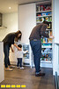 The Kao family kitchen, designed by RAO Design Studio, is open and spacious thanks to removing walls and adding glass; white cabinets and large light tile. The built in refrigerator and small powerful appliances and smart shelving makes use of space and keeps lines and storage clean and orderly. (Jenni Girtman/ info@atlantaeventphotography.com)