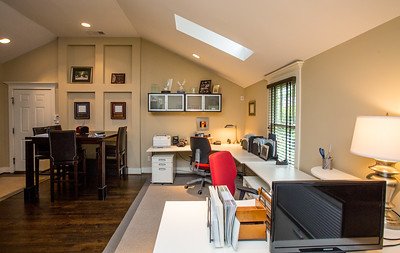 Patti Ellis, a local realtor, and her husband, a builder, use their carriage house in Midtown as an office.  The two car garage is below the carriage house.  The space has been used as a one bedroom apartment, with a full kitchen and an open floor plan.  (Jenni Girtman/ Atlanta Event Photography)