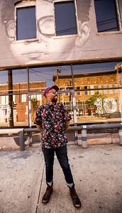 In front of one of his most recent investments, Miya Bailey is a business owner and investor in Castleberry Hill.  He is a tattoo artist who owns City of Ink Tattoos and art galleries all along Walker Street.  (Jenni Girtman / Atlanta Event Photography)
