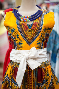 Traditional African fabrics and clothing are available at AfroCentric Network where fabrics from Ghana and Kenya are in great supply.  Dashiki garments have a central colorful design that is the center feature of these Aftrican garments..  (Jenni Girtman / Atlanta Event Photography)
