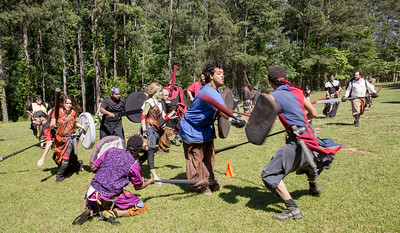The local High Spires chapter practices with a game of Capture the Flag in Blackburn Park.  Selkie aka Meredith Furbish of Brookhaven, center, has the flag as her teamdefends the position as she aims to get the flag to the cone.  The live action game is a full-contact combat game that uses foam padded boffer weaponry. The High Spires is an official Dagorhir Battle Games chapter, focusing their efforts on veterans and new members.  (Jenni Girtman / Atlanta Event Photography)