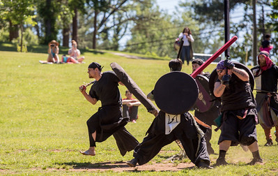 The local High Spires chapter begins a game of Capture the Flag during practices on weekends in Blackburn Park.  The live action game is a full-contact combat game that uses foam padded boffer weaponry. The High Spires is an official Dagorhir Battle Games chapter, focusing their efforts on veterans and new members.  (Jenni Girtman / Atlanta Event Photography)