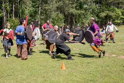 The local High Spires chapter practices with a game of Capture the Flag in Blackburn Park.  Selkie aka Meredith Furbish of Brookhaven, far left, has the flag as her teams defends the position as she aims to get the flag to the cone.  The live action game is a full-contact combat game that uses foam padded boffer weaponry. The High Spires is an official Dagorhir Battle Games chapter, focusing their efforts on veterans and new members.  (Jenni Girtman / Atlanta Event Photography)