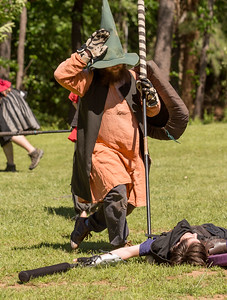 Ray Almand, with the charater name Slayface indicates his dead status after both players need to regenerate after a battle.  The local High Spires chapter practices on weekends in Blackburn Park.  The live action game is a full-contact combat game that uses foam padded boffer weaponry. The High Spires is an official Dagorhir Battle Games chapter, focusing their efforts on veterans and new members.  (Jenni Girtman / Atlanta Event Photography)