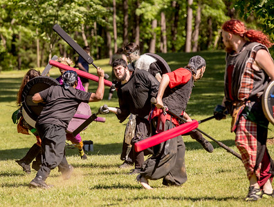 The local High Spires chapter practices on weekends in Blackburn Park.  The live action game is a full-contact combat game that uses foam padded boffer weaponry. The High Spires is an official Dagorhir Battle Games chapter, focusing their efforts on veterans and new members.  (Jenni Girtman / Atlanta Event Photography)