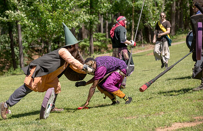 The local High Spires chapter practices on weekends in Blackburn Park.  Ray Almand with the character name Slayface works to stop Vayne, also known as Ronnie Hardeman, of Decatur from gaining points in their game of Ring The Bell.  The live action game is a full-contact combat game that uses foam padded boffer weaponry. The High Spires is an official Dagorhir Battle Games chapter, focusing their efforts on veterans and new members.  (Jenni Girtman / Atlanta Event Photography)