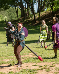 "Playing ""Ring the Bell"" Victoria Abel of Warrner Robbins, whose character name is Turweh, far right, battles during practice at Blackburn Park.  The live action game is a full-contact combat game that uses foam padded boffer weaponry. The High Spires is an official Dagorhir Battle Games chapter, focusing their efforts on veterans and new members.  (Jenni Girtman / Atlanta Event Photography)"