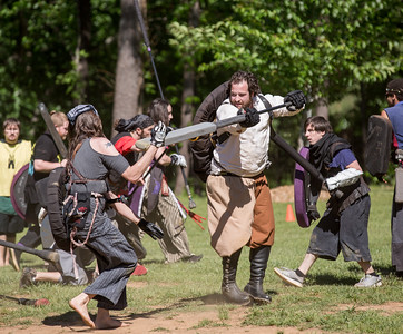 Nikki Dyer of Athens with the character name Mothy, is taken out of the game by Fivel aka Josh Weinberg of Sandy Springs during  the local High Spires chapter practice in Blackburn Park.  The live action game is a full-contact combat game that uses foam padded boffer weaponry. The High Spires is an official Dagorhir Battle Games chapter, focusing their efforts on veterans and new members.  (Jenni Girtman / Atlanta Event Photography)