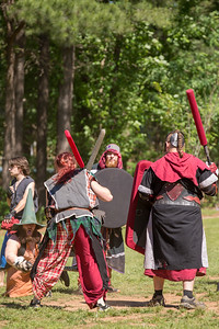 Joey Sellers, with character name  t3c#kn0w3 !!!, defends his position with his team during the local High Spires chapter practices in Blackburn Park.  The live action game is a full-contact combat game that uses foam padded boffer weaponry. The High Spires is an official Dagorhir Battle Games chapter, focusing their efforts on veterans and new members.  (Jenni Girtman / Atlanta Event Photography)