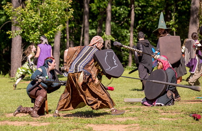 The local High Spires chapter, including  Twish aka Donovan Winters of Augusta, with rat on shield, practices on weekends in Blackburn Park.  The live action game is a full-contact combat game that uses foam padded boffer weaponry. The High Spires is an official Dagorhir Battle Games chapter, focusing their efforts on veterans and new members.  (Jenni Girtman / Atlanta Event Photography)