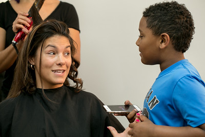 White Diamond Image Consulting offers more than standard salon offerings not only hair, makeup and nail services but also before and after photography shoots, neck massage, tea and extra pampering for women only.  Nicole Castoreno, a mother of two, including her 6-year-old Anthony Boswell, gets a Mommy Makeover with Cherise B Thomas doing her hair, Treva D Cameron taking care of her manicure and pedicure and make up by Shirley Adrien at the salon.   (Jenni Girtman / Atlanta Event Photography)