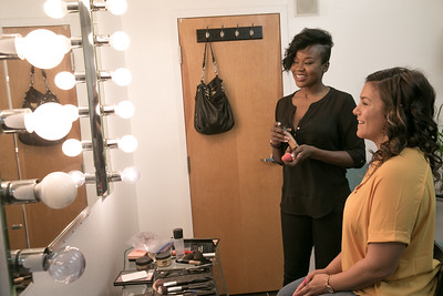 White Diamond Image Consulting offers more than standard salon offerings not only hair, makeup and nail services but also before and after photography shoots, neck massage, tea and extra pampering for women only.  Nicole Castoreno, a mother of two, gets a Mommy Makeover as Shirley Adrien takes care of her make up at the salon.   (Jenni Girtman / Atlanta Event Photography)
