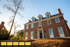 The Handley's historic home was demolished by a fire and has been painstakingly restored to match photos and sales brochures of the home before the fire.