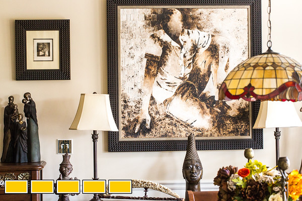 Jean-Patrick Guichard is a long-time collector of African art, he is at his Fairburn home, and plans a gallery opening in metro Atlanta in 2018.  This painting is what inspired him to start a gallery.  He purchased the piece at a Sengal art community and the artist started asking when Guichard was going to have a show in the US for them, rather than just buying a painting here and there.  Guichard was born in New York and raised in West Africa and has pieces passed down from his mother as well as an expansive set of paintings, sculpture, ceremonial masks and artifacts he has secured through years of searching.  Many of the works are early works of now prolific and well known artists.  Guichard begins relationship at art school and art communities in Africa.  (Jenni Girtman / Atlanta Event Photography)